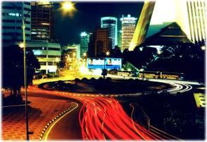 Kuala Lumpur, Malaysia, at night. Showing streaks of car tail lights.